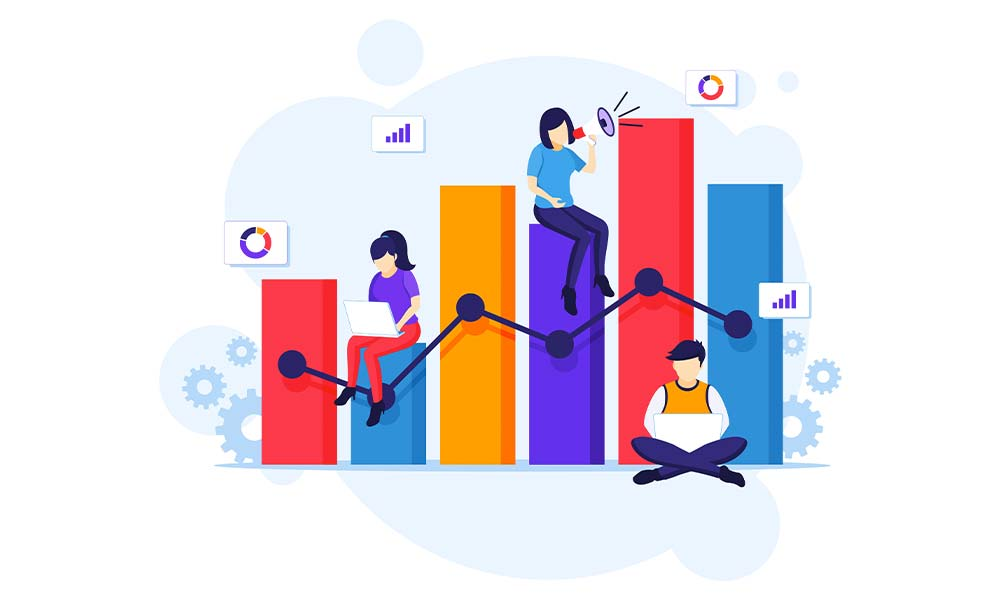 Small business owners developing their marketing plans near a big chart